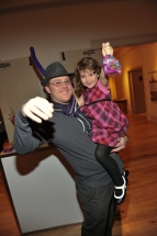 "Actor Joel Keller of ""Men With Brooms"" with daughter having fun at the candy bar"